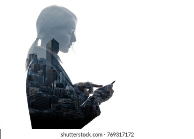 Double exposure of businesswoman and building exterior.