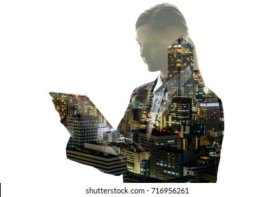 double exposure of businesswoman and modern city.