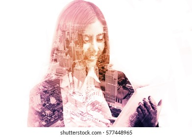 Double Exposure of Businesswoman use Wireless digital Mobile Tablet with Modern City Building or Cityscape as Business Technology Concept.