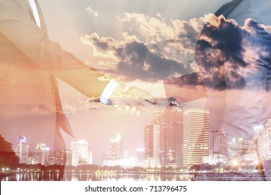 Double exposure of bussiness man and cityscape background