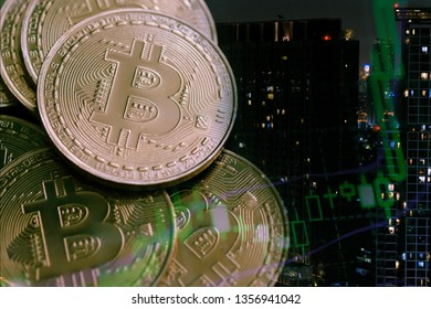 Double exposure of candle stick on bitcoins in economic grown and financial investment background concept. Column graph market business concept.