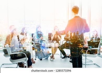 Double exposure city background.Business, startup, presentation, strategy and people concept - men making presentation to creative team at office.