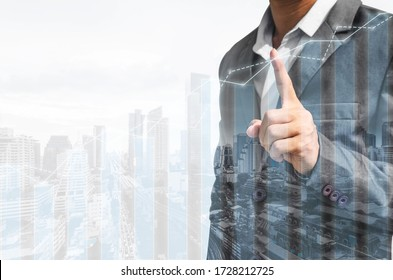 double exposure city and business man pointing marketing and finance graph and chart report growth analysis successful. investment strategy plan. grow economic concept.