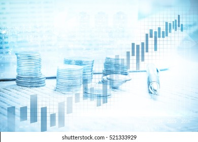 Double exposure of city and coin stack on banking account in the background with chart and graph