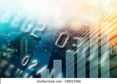 Double exposure of city, credit card and graph for finance and business concept