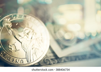 Double exposure of city, dollar coins and dollar banknotes for finance and banking concept background