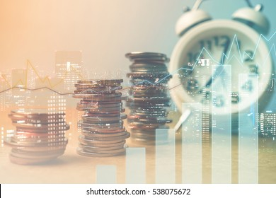 Double exposure of city, graph , alarm clock and rows of coins for finance and business concept