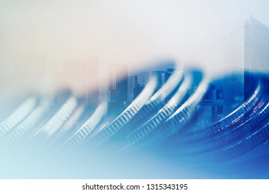 Double exposure of city and rows of coins for finance and business concept background