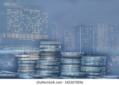 Double exposure of city and rows of coins for money, finance and business concept of teamwork and partnership.