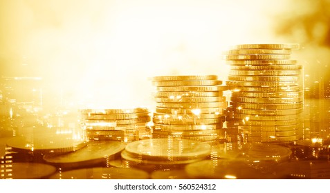 Double exposure of city and stack of coins for finance and banking concept