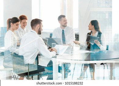 Double exposure of cityscape view and people working at table in office. Concept of financial trading