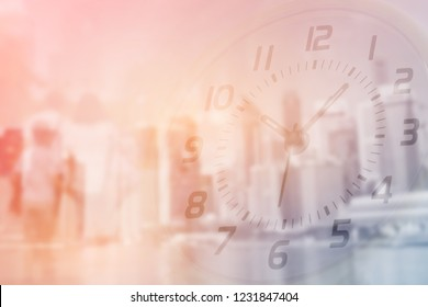 Double exposure of clock and people walking with blurred building