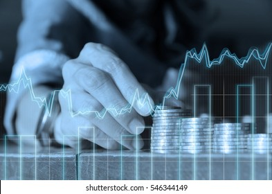 Double exposure of Close up people hand putting coins on the row and business graph in finance and banking concept