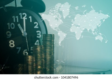 Double exposure coin stack alarm clock stock photo edit now double exposure of coin stack and alarm clock with city background and world map financial gumiabroncs Image collections