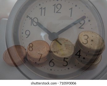 double exposure of coins and clock for financial concept.  time is money.