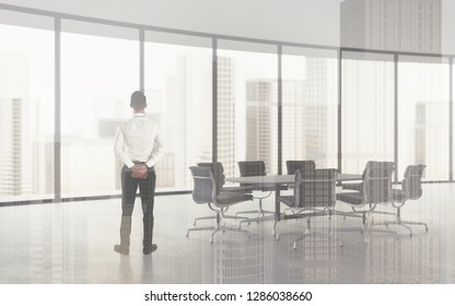 Double exposure concept of businessman in modern office