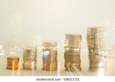 Double exposure condo of coins with night city background, Finance and banking concept