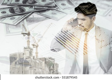 Double exposure of construction site and businessman on the phone.Real estate concept