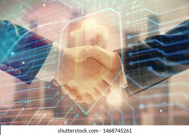 Double exposure of crypto economy theme drawing on cityscape background with handshake. Concept of partnership and blockchain