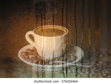 Double exposure of cup of coffee and rain on window