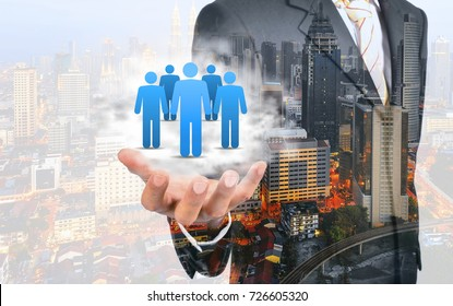 Double exposure of Customer care, care for employees, labor union, CRM, and life insurance concepts. Protecting gesture of businessman with icons representing group of people.
