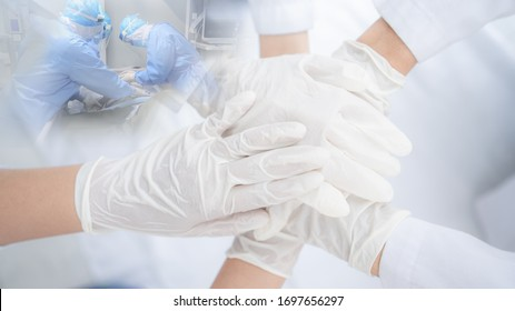 Double exposure of doctors holding hands together at hospital with blurred doctors and patient in background