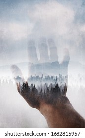 Double exposure effect on combined  photographs of misty forest and hand