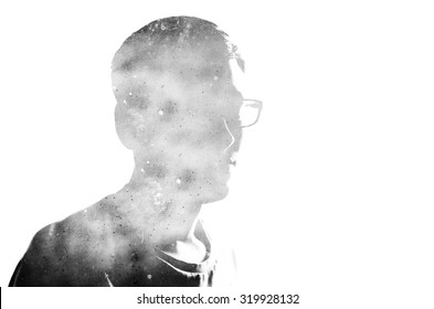 Double exposure effect on the photo with black silhouette on the white background and old vintage scratched and dirty paper