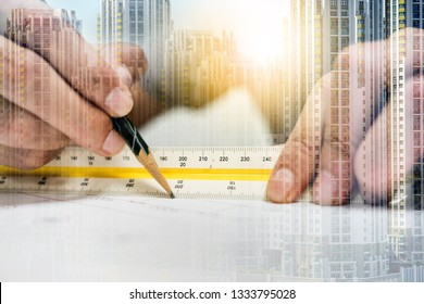 Double exposure engineer are measuring distance in drawing using pencil and ruler and city. Engineering and architect concept.