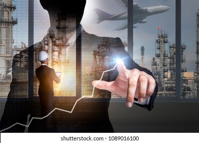 Double exposure of Engineer with safety helmet and businessman with financial symbols coming from hand on  oil refinery industry plant background