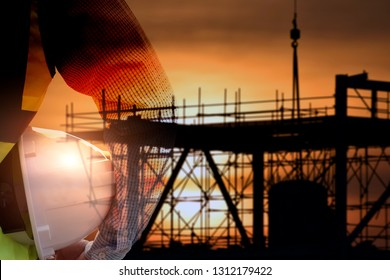 Double exposure of  Engineer or Safety officer holding hard hat with construction site.