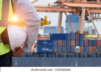 Double exposure of  Engineer or Safety officer holding hard hat with logistic import export .