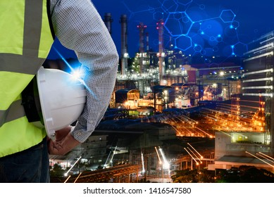 Double exposure of  Engineer or Safety officer holding hard hat with oil refinery plant.