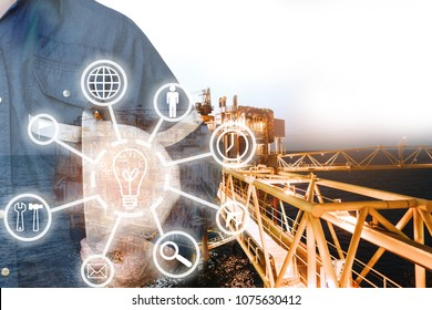 Double exposure of Engineer or Technician man with industry tool icons for management business by holding safty helmet & uniform for oil and gas industrial business concept.