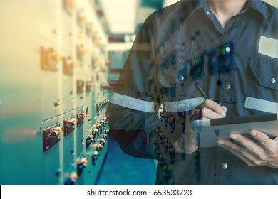 Double exposure of Engineer or Technician man working with tablet in switch gear electrical room oil and gas platform or plant industrial for monitor process, business and electrical industry concept.