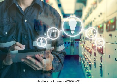Double exposure of Engineer or Technician man using  tablet in switch gear electrical room oil and gas platform or plant industrial with tools icon, business and electrical industry concept.