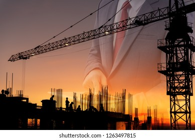 Double exposure Engineers construction and Silhouette construction  workers with Crane construction and team working in site. construction safety concept  background sunset