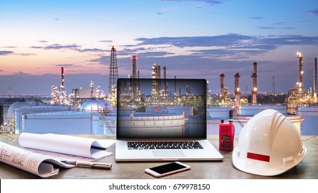 Double exposure Engineers holding safety helmet in arms and holding walk talky in hands with oil and gas refinery background on industry concept