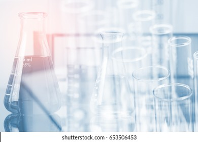 Double exposure of equipment and science experiments ,Laboratory glassware containing chemical liquid, science research,science background and science concept.