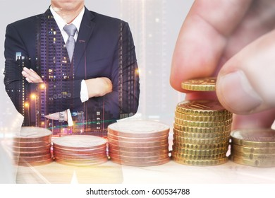 double exposure of Euro Coin stacks on table, businessman arms crossed and light trails on night street as business, investment,currency, exchange rate concept