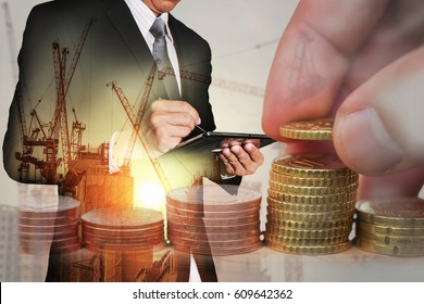 Double exposure of Euro Coin stacks on table, businessman working with tablet, construction crane, building and sunset as business, investment,currency, exchange rate, technology and industry concept.