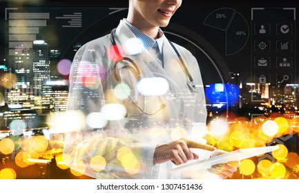 Double exposure of female doctor in white medical uniform touching tablet with her finger and night city view and media interface on background, Conceptual image of modern medical industry