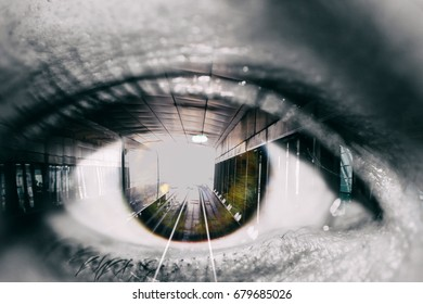 Double exposure of the female eye and tunnel with train car in subway