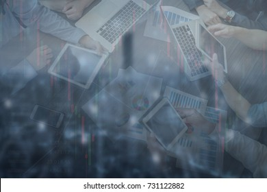 Double exposure of finance graph and and Business meeting group with technology device