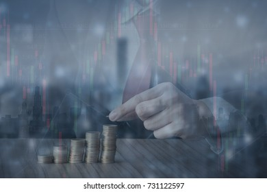 Double exposure of finance graph and Close up Hand  of Business man putting money coins stack growing,Business money concept