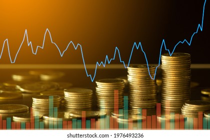 Double exposure of finance graph , stationary and rows of coins for goal office , finance and business concept background and forex trading graph with economy trends business or finance background.