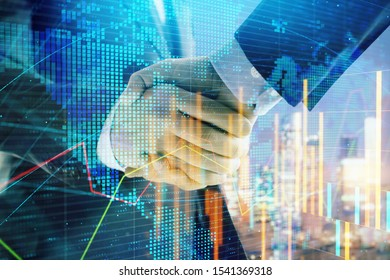 Double exposure of financial chart and world map on cityscape background with two businessmen handshake. Concept of international investment