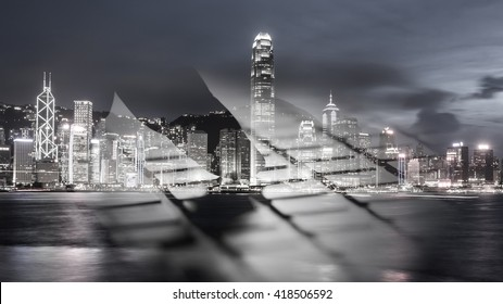 Double exposure. Finger press on computer with Hong Kong city background. Black and white image