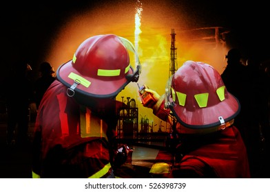 Double exposure of  Fireman and refinery plant  , concept crisis a large oil refinery fire and emergency fire case.