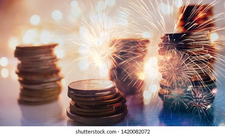 Double exposure of fireworks and rows of money coins on light bokeh for finance , money , investment and business concept background
